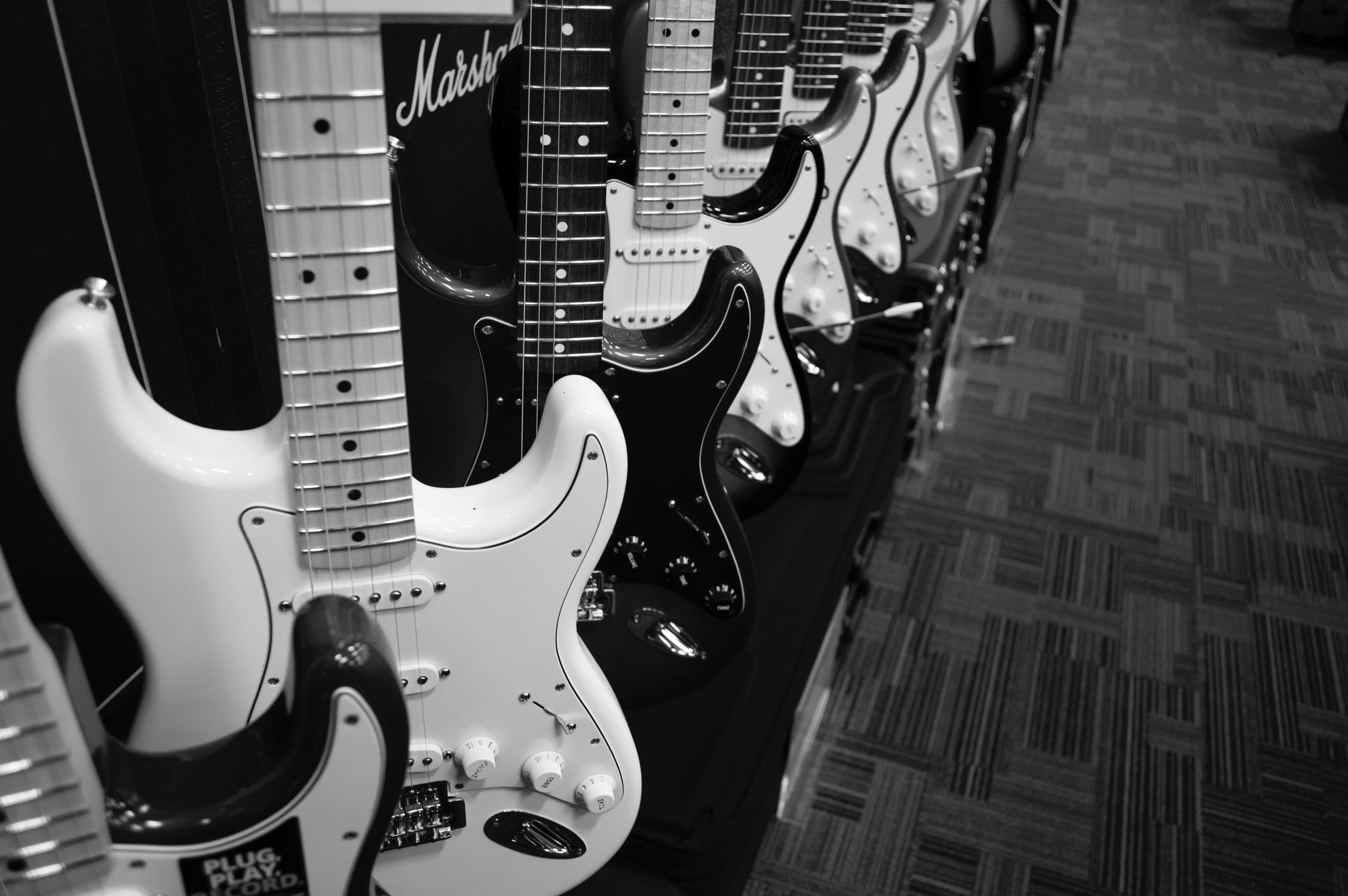 wall of electric guitars